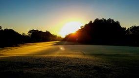 Lever de soleil au-dessus du 18ème trou Images stock