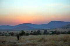 Lever de soleil au-dessus de parc national de Pilanesberg Image stock