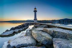 Lever de soleil au phare de Paquis, ville de Genève Images libres de droits