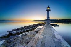 Lever de soleil au phare de Paquis, ville de Genève Photographie stock
