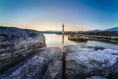 Lever de soleil au phare de Paquis, ville de Genève Photographie stock libre de droits