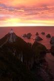 Lever de soleil avec le phare Photographie stock libre de droits
