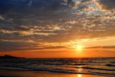 Lever de soleil côtier Image libre de droits