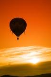 Lever de soleil chaud de ballon à air Images stock
