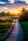 Lever de soleil de coucher du soleil de ciel de chemin Image libre de droits