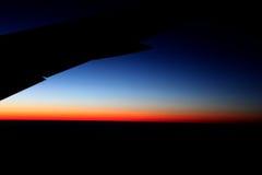 Lever de soleil d'un avion Photographie stock