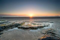 Lever de soleil dans Bamburgh photographie stock libre de droits