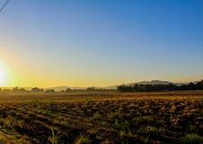 Lever de soleil dans le pays photos stock