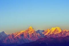 Lever de soleil de montagnes de Minya Konka Images libres de droits