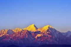 Lever de soleil de montagnes de Minya Konka Photo stock