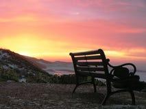 Lever de soleil de plage de banc Photographie stock libre de droits