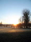 Lever de soleil de terrain de golf Photographie stock libre de droits