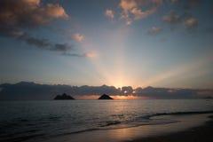 Lever de soleil en mer Photos stock