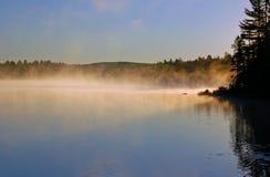 Lever de soleil et brouillard Photographie stock libre de droits