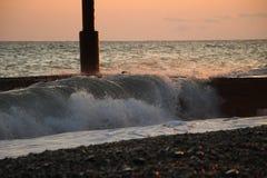Lever de soleil marin sur le pilier Image stock