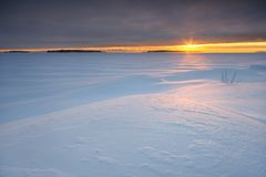 Lever de soleil nuageux Photos stock