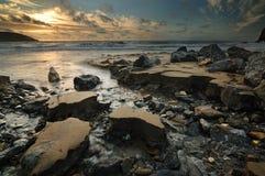 Lever de soleil par la mer Images libres de droits