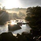 Lever de soleil par la rivière Images stock