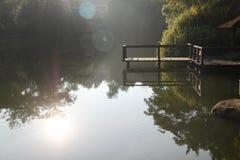 Lever de soleil par le lac Photo stock