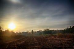 Lever de soleil sur la campagne Photo stock