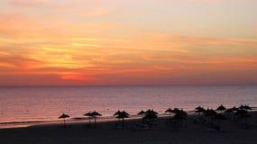 Lever de soleil sur la plage Image libre de droits
