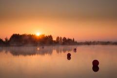 Lever de soleil sur le lac Photo libre de droits
