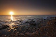 Lever de soleil sur le point Cartwright, côte de soleil photographie stock libre de droits