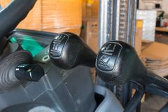 The lever hydraulic system of forklifts. The lever hydraulic system of forklifts Stock Photo