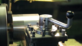 Lever locks the pressure on the surface on which the cutter lathe. stock video footage