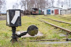 Lever on narrow gauge railway tracks. An old roundhouse in central europe stock image
