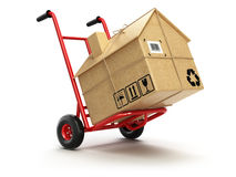 Leverans eller rörande houseconcept Handlastbil med kartong a Royaltyfri Foto