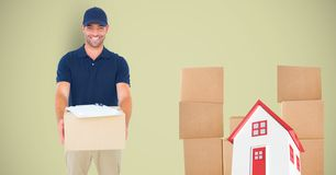 Leveringsmens met pakketten en 3d huis Stock Fotografie