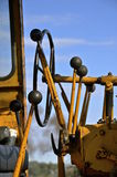Levers of a road grader Stock Photos