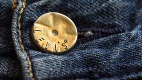 Levi's button. KUALA LUMPUR, MALAYSIA - 22TH FEBRUARY 2015; Levi Strauss & Co is a privately held American clothing company known worldwide for its Levi's brand Stock Images