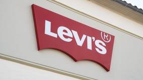 Levi Strauss znak na ścianie zdjęcie stock