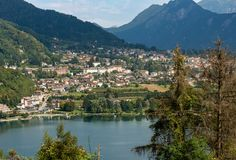 Levico Terme and Lake - Trentino Italy. Aerial view of the small town of Levico Terme with the lake and the mountains. Trentino Alto Adige, Italy, Europe Royalty Free Stock Images