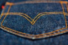 Levis jeans, tyg, grov bomullstvillindigoblått Royaltyfri Foto