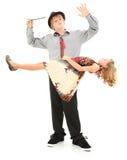 Levitação mágica da mostra da criança do menino e da menina. Fotografia de Stock Royalty Free