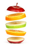 Levitating fresh sliced fruit stock image