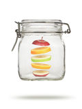 Levitating fruit in glass jar Royalty Free Stock Images