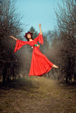 Levitating girl among the trees. Royalty Free Stock Image