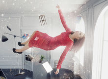 Levitating young woman in magical interior Royalty Free Stock Images
