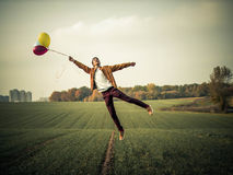 Levitation. Boy levitation on the field. Royalty Free Stock Images