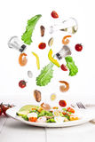 Levitation of Delicious appetizing vegetable salad with seafood on a white plate. Stock Photo