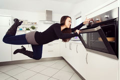 Levitation in the kitchen Stock Image