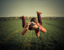 Levitation. Levitation of a guy with a camera Royalty Free Stock Photos