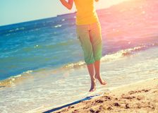 Young woman levitating on the beach stock photos