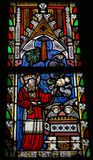 Leviticus 7:35. Stained glass window in the church of Our Lady in Saint Truiden, Belgium. This window depicts Leviticus 7:35: This is the portion of the Royalty Free Stock Photography