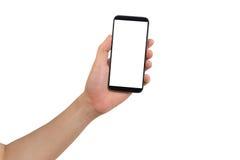 Lewa ręka trzyma białego puste miejsce na parawanowym telefonie komórkowym Zdjęcie Stock