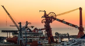 Lewek Constellation - Emas, industrial pipelay ship anchored in the port of Genoa Italy at sunset royalty free stock images